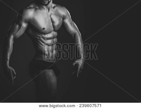 Dieting And Fitness, Healthy Lifestyle. Sport And Workout. Athletic Bodybuilder Man On Black Backgro