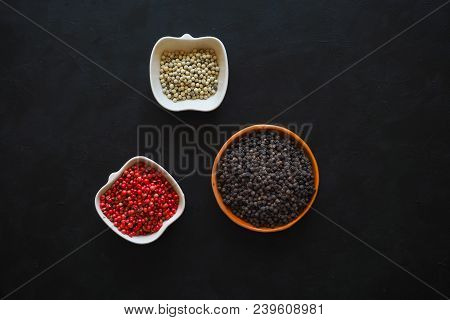 Spices: Black Pepper, Pink Pepper And White Pepper In A Bowl. The View From The Top.