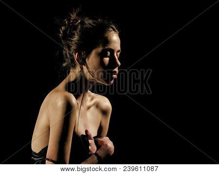 Girl With Oily Or Wet Skin On Black Background. Purity, Perfection, Sensuality Concept. Woman With S