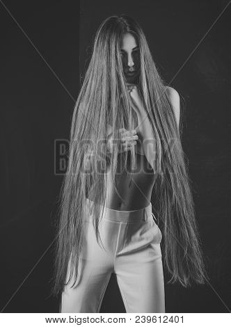Beauty Salon And Fashion. Girl Has No Makeup And Healthy Hair On Black Background. Haircare And Sham