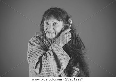 Senior Woman In Pension And Retirement. Haircare And Beauty. Woman Comb Long Red Hair. Hairdresser A