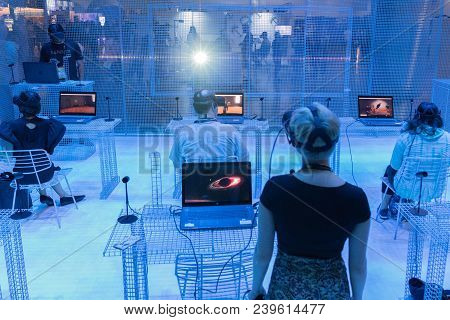 People Use Equipment To Play A Virtual Reality Game