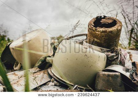 Kitchen scrap metal lying on top of rusty zinc roofing poster
