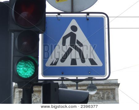 A Walk Sign And Green Light In St Petersburg, Russia