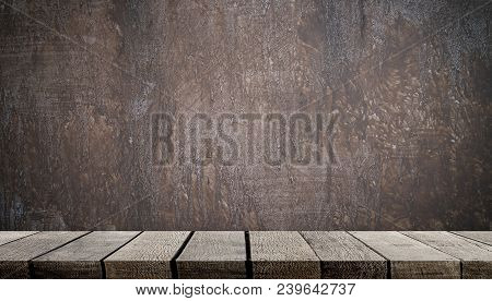 Empty Wooden Shelf On Gray Cement Wall For Product Display