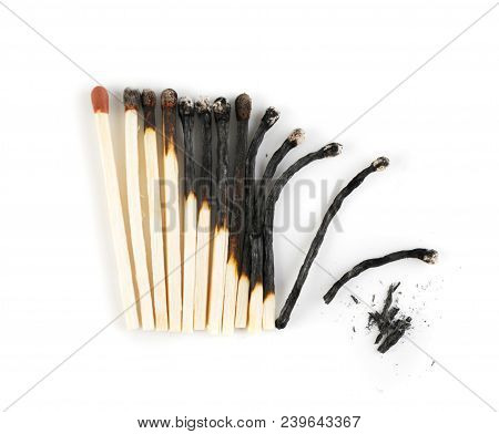 Different Stages Of Burnt Matches On Light Grey Background Top View. Charred Wood Sticks Flat Lay