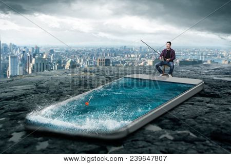 Man fishing in the smartphone screen with water