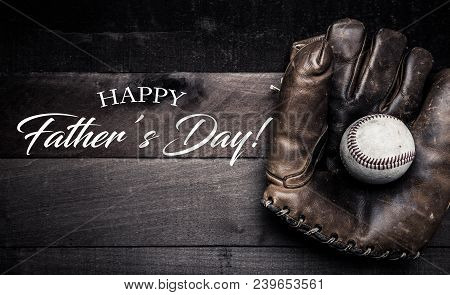 Vintage Baseball Gear On A Wooden Background With Father's Day Greeting
