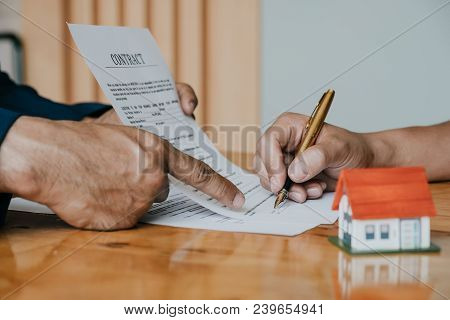 Client Signing A Real Estate Contract In Real Estate Agency Selective Focus At House Model