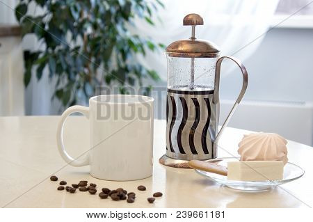 Coffee Mug Mockup In The Kitchen Interior. White Ceramic Cup On The Table With A French Press And So
