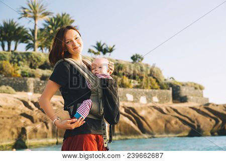 Mother With Baby On Coastline Ocean On Tenerife, Spain.