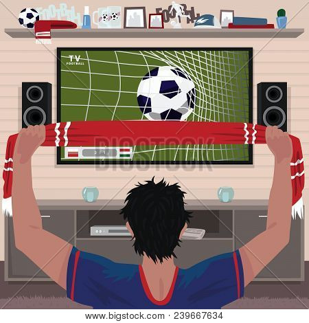 Football Fan Rejoices At The Goal. Viewing Soccer Game At Home On Big Tv. Interior Room Of Football