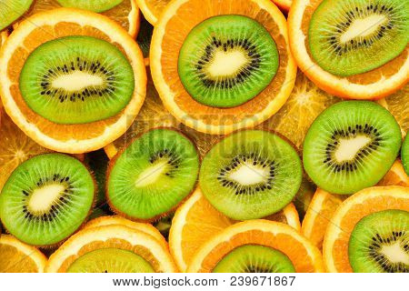 Fruity Background Set Of Slices Of Orange Fruit And Kiwi. Many Slices Of Kiwi Fruit And Orange Fruit