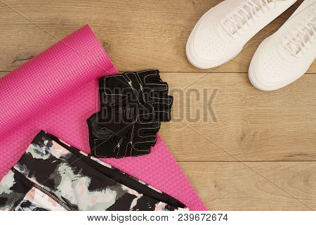 Female Sneakers, Sport Shoes, Leggings And Training Gloves In Flat Lay Style, Top View. Fashion Tren