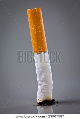 cigarette end on a grey background