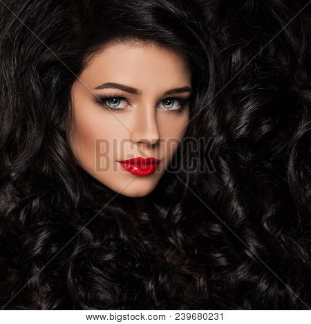 Perfect Brunette Woman With Healthy Wavy Hair And Makeup. Haircare Concept