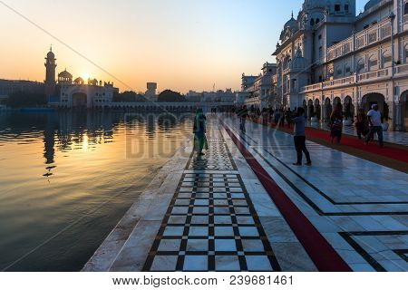 Amritsar, India - March 18, 2017: People At The Golden Temple Amritsar, Punjab, India, The Most Sacr