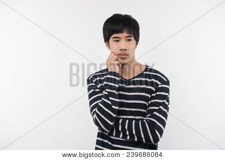 Pensive Mood. Serious Thoughtful Man Holding His Cheek While Thinking About Life