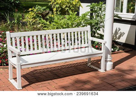 Place To Rest - White Lacquered Wooden Bench In The Garden