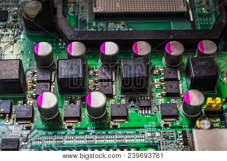 Closeup On Electronic Board In Hardware Repair Shop, Blurred And Toned Image