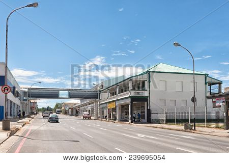 Ladysmith, South Africa - March 21, 2018: A Street Scene, With Businesses, A Pedestrian Bridge And V