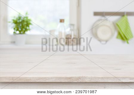 Wooden Table Top In Front Of Blurred Kitchen Interior Background