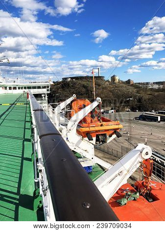 Lifeboats, Decks And Cabins On The Side Of Cruiseship. Wing Of Running Bridge Of Cruise Liner. White