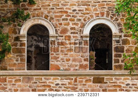 Two Window Gaps On The Stone Facade Of The Abandoned Old Mansion Called Dacha Kvitko, Sochi, Russia