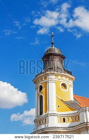 Gull Perched On The Cross Of A Church Spire At Cluj-napoca, Romania. Architectural Detail.