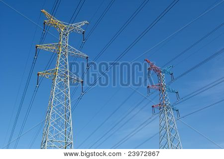 High voltage power pylons in blue ksy poster