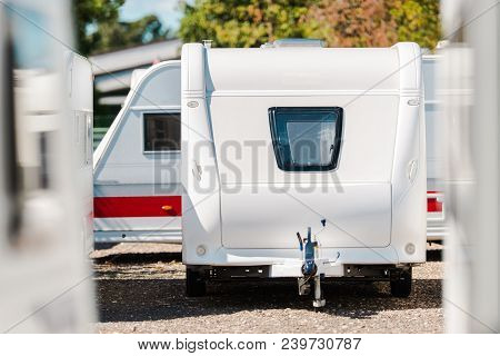 Rv Travel Trailer Storage Parking. Modern Recreational Trailer With Front Window. Camping And Travel