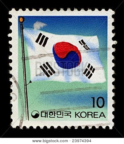 KOREA-CIRCA 1993:A stamp printed in Korea shows image of The flag of South Korea, or Taegeukgi has three parts: a white background; a red and blue taegeuk in the centre, circa 1993.