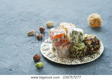 Oriental Sweets. Turkish Delight On A Gray Background. The View From The Top. Copy Space