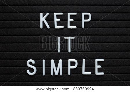 The Words Keep It Simple In White Plastic Letters On A Black Letter Board As A Reminder For When Pla