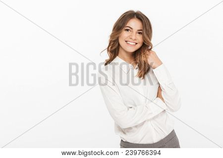 Portrait of a smiling young business woman looking at camera isolated over white background