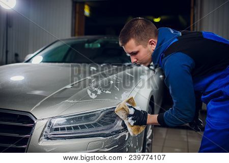 Outdoor Car Wash With Yellow Sponge. Beautiful Man Washes The Car