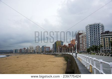 Photo Of A Beach With Several Buildings And Sunlight