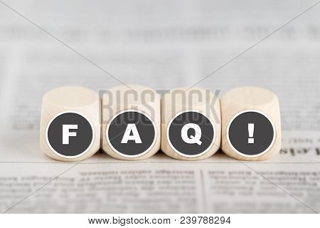 The Phrase Faq On Cubes On A Newspaper