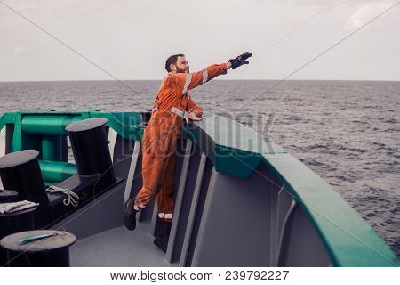 The Fisherman Throws A Hook On A Ship For Catching Tuna Fish. Fishing At Sea. He Holds Fishing Line