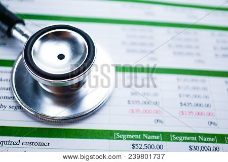 Stethoscope On Spreadsheet Report Paper, Finance, Account, Statistics, Investment, Analytic Research