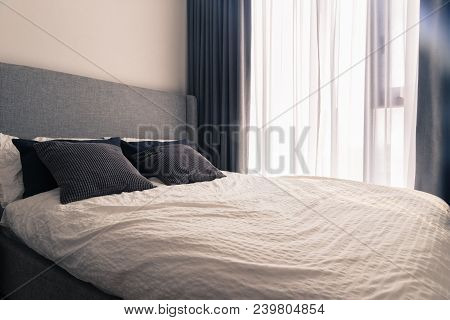 Modern King Size Bed In Narrow Condo Bedroom With Wrinkle Bedding Sheet Fabric, Pillow Cushion, Doub
