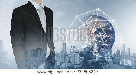 Global Network And International Global Business. Double Exposure Businessman And City Background Wi
