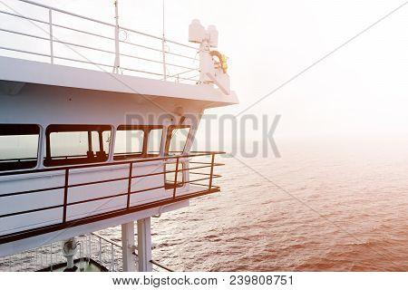 Cruise Ship White Cabin With Big Windows. Wing Of Running Bridge Of Cruise Liner. White Cruise Ship