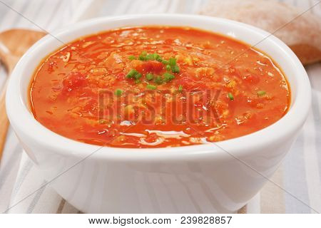 A Bowl Of Lentil And Tomato Soup Garmished With Chives. More Soup:- Url Http: Www.istockphoto.com Fi