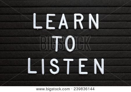 The Words Learn To Listen In White Plastic Letters On A Black Letter Board As A Reminder For When De