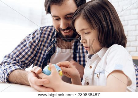 Adult Father Helps Son Learn Geography Using Globe. Studies Of Geography. Self Education Concept.