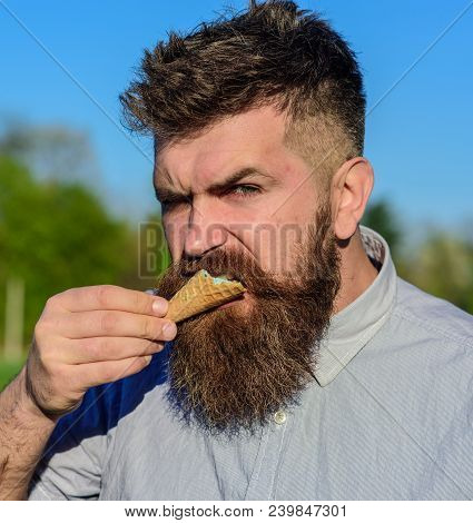 Sweet Tooth Concept. Bearded Man With Ice Cream Cone. Man With Beard And Mustache On Strict Brutal F