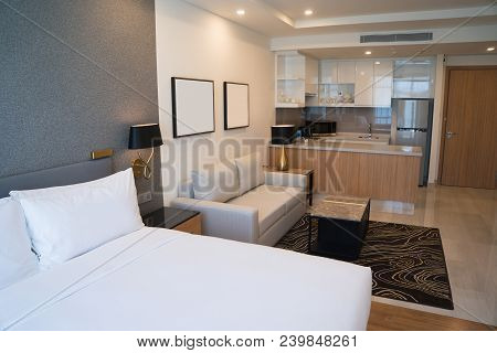 Comfortable Studio Apartment Design. Hotel Room Interior With Bedroom Area, Living Space And Kitchen