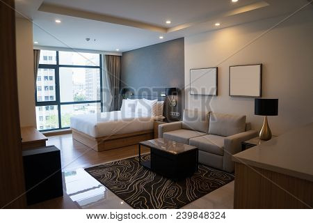 Cozy Studio Apartment Design With Bedroom And Living Space. Hotel Room Panoramic Window, Double Bed,
