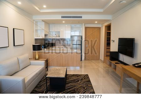 Modern Interior Design Of Studio Apartment. Hotel Room With Living Space And Kitchen Corner Counter